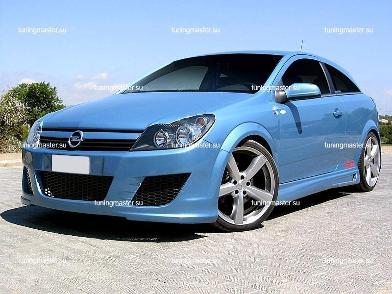 Накладки на фары Opel Astra H фигурные